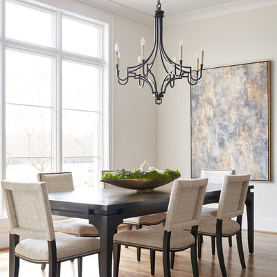 Example of a mid-sized transitional medium tone wood floor and beige floor enclosed dining room design in Dallas with white walls