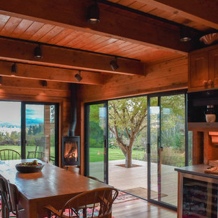 Inspiration For A Rustic Medium Tone Wood Floor And Brown Floor Dining Room  Remodel In Seattle