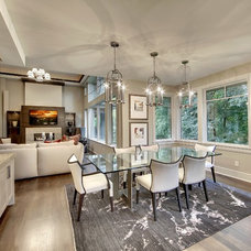 Transitional Dining Room by SKD Architects