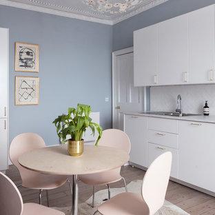 Medium sized classic kitchen/dining room in Edinburgh with light hardwood flooring, grey floors and blue walls.