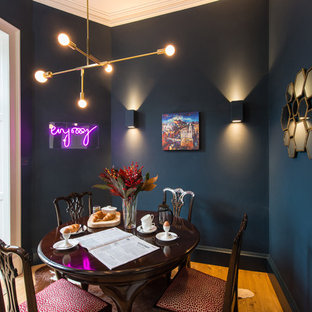 Inspiration for a traditional dining room in Other with blue walls, medium hardwood flooring and no fireplace.