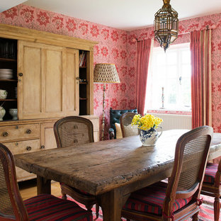 Inspiration for a classic dining room in Gloucestershire with multi-coloured walls, medium hardwood flooring and no fireplace.