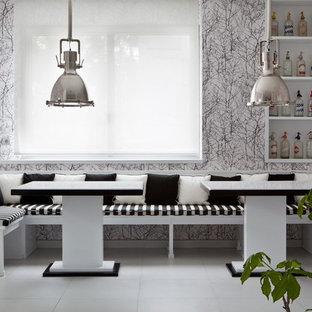 Ispirazione per una grande sala da pranzo minimal con pavimento con piastrelle in ceramica