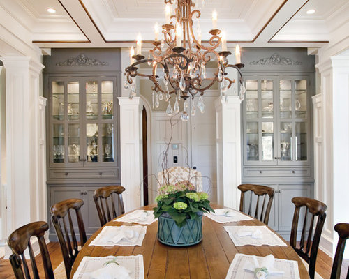 Example Of A Classic Medium Tone Wood Floor Dining Room Design In Charleston