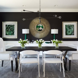 Transitional gray floor and medium tone wood floor enclosed dining room photo in DC Metro with black walls