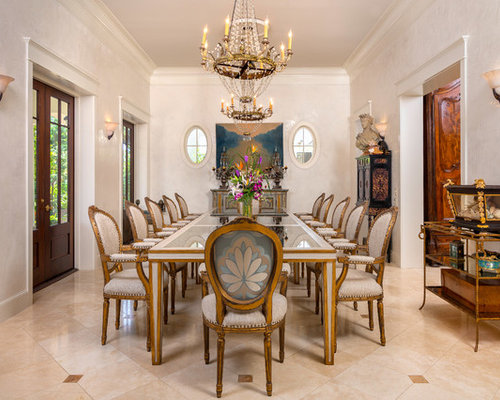 Example Of A Tuscan Beige Floor Enclosed Dining Room Design In Miami With White Walls