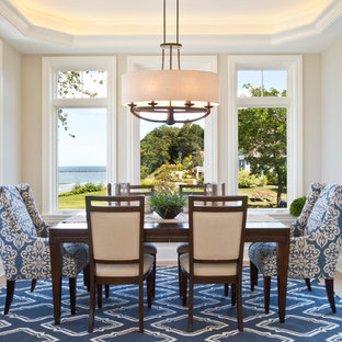 Inspiration for a large beach style light wood floor great room remodel in Grand Rapids with beige walls