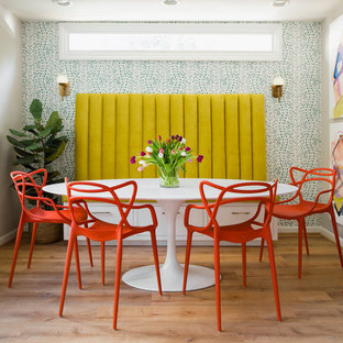 Example Of A Small Eclectic Light Wood Floor Dining Room Design In Atlanta  With Multicolored Walls