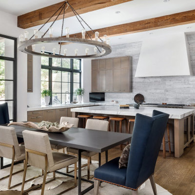Inspiration for a contemporary medium tone wood floor great room remodel in Austin with white walls and no fireplace