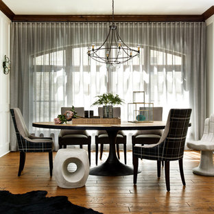 Inspiration for a contemporary medium tone wood floor dining room remodel in Milwaukee with white walls