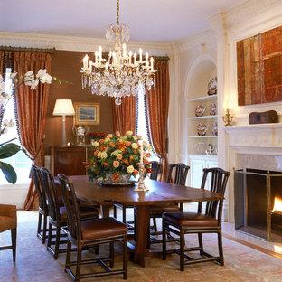 Esempio di una grande sala da pranzo chic con pareti marroni, camino classico e cornice del camino in pietra