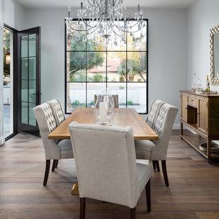 Tuscan medium tone wood floor and brown floor dining room photo in Phoenix with gray walls