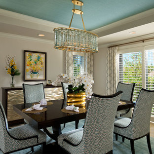 Photo of a coastal enclosed dining room in Miami with beige walls.