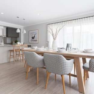 Inspiration for a scandinavian light wood floor and beige floor kitchen/dining room combo remodel in Melbourne with gray walls