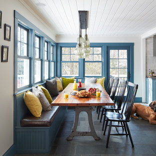 Inspiration for a cottage gray floor kitchen/dining room combo remodel in Manchester with white walls