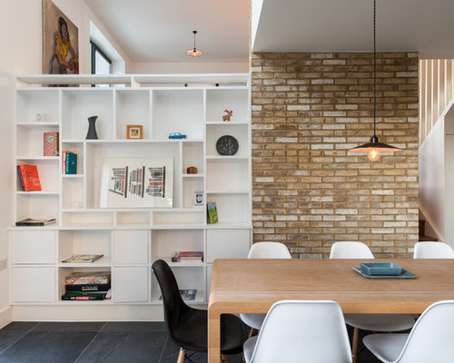 Inspiration For A Modern Dining Room In London With White Walls And Slate Flooring