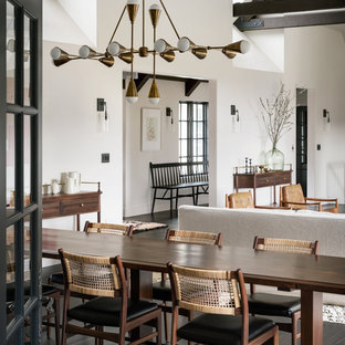 Example of a tuscan dark wood floor and brown floor dining room design in Portland with white walls