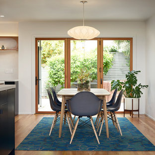 Example of a small midcentury modern light wood floor and beige floor kitchen/dining room combo design in San Francisco with gray walls