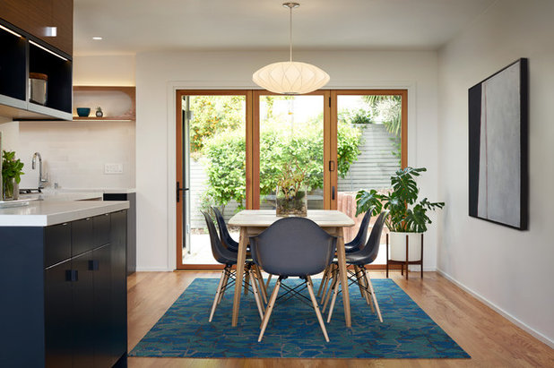 Midcentury Dining Room by Eisenmann Architecture