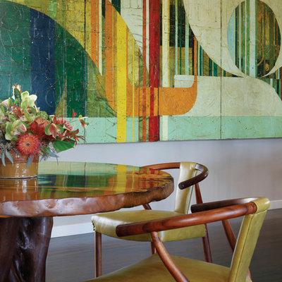 Example of a trendy dark wood floor dining room design in Hawaii