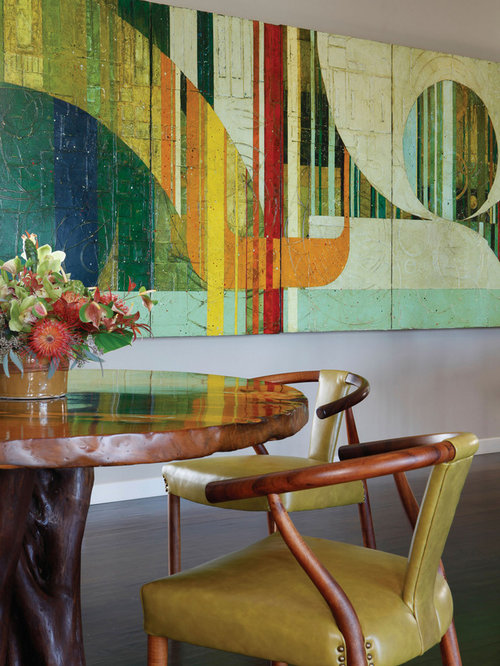 Example Of A Trendy Dining Room Design In Hawaii With Dark Wood Floors