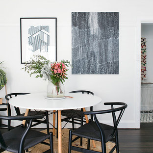 Inspiration for a mid-sized scandinavian open plan dining in Sydney with white walls, dark hardwood floors and brown floor.