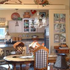 Mediterranean Dining Room by Cornerstone Interiors