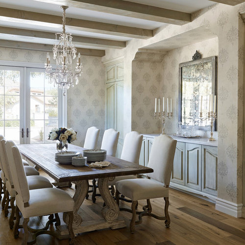 Example Of A Tuscan Medium Tone Wood Floor Dining Room Design In Phoenix  With Multicolored Walls