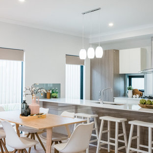 Inspiration for a contemporary kitchen/dining combo in Perth with white walls, light hardwood floors and beige floor.
