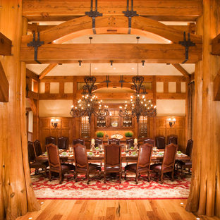 Expansive rustic enclosed dining room in Jackson with beige walls, medium hardwood flooring and no fireplace.