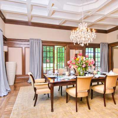 Inspiration for a large timeless medium tone wood floor enclosed dining room remodel in San Francisco with beige walls and a standard fireplace
