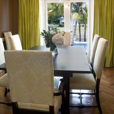 Tropical Dining Room by DawnElise Interiors
