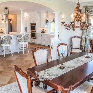 Immagine di una grande sala da pranzo aperta verso il soggiorno shabby-chic style con pavimento con piastrelle in ceramica, pareti beige e nessun camino