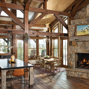 Mountain style dark wood floor and brown floor great room photo in Denver with beige walls