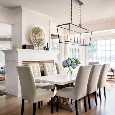 Example of a large transitional light wood floor great room design in New York with white walls, a brick fireplace and a standard fireplace