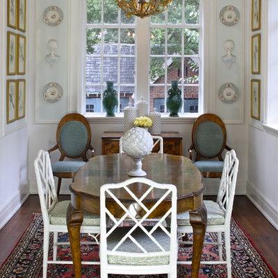 Large elegant dark wood floor kitchen/dining room combo photo in Atlanta with white walls