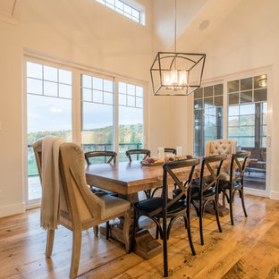 Example of a mid-sized transitional light wood floor great room design in Orange County with white walls and a stone fireplace