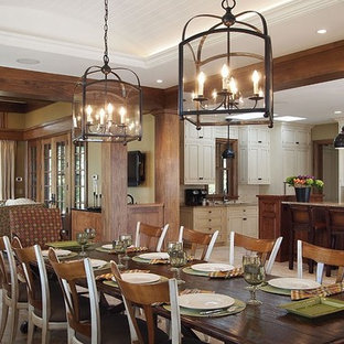 Example of a large mountain style light wood floor great room design in Boston with no fireplace