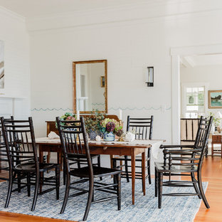 Inspiration For A Coastal Dining Room In Boston With White Walls Medium Hardwood Flooring