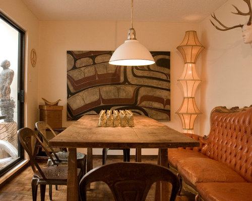 Example Of An Eclectic Dark Wood Floor Enclosed Dining Room Design In Vancouver With Beige Walls