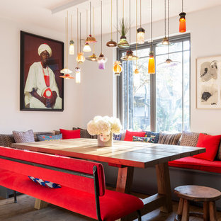 Eclectic dining room in London with white walls, dark hardwood flooring and brown floors.