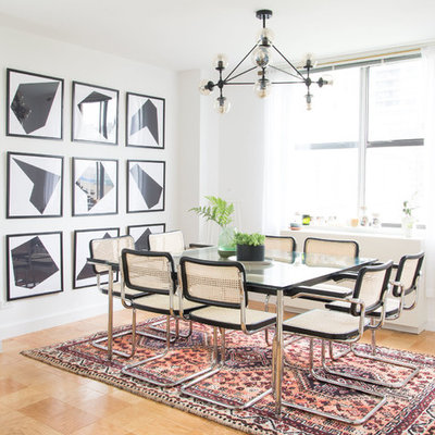 Inspiration for a scandinavian plywood floor and brown floor dining room remodel in Other with white walls