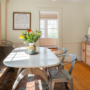 Inspiration for a mid-sized cottage medium tone wood floor and brown floor enclosed dining room remodel in Portland Maine with beige walls