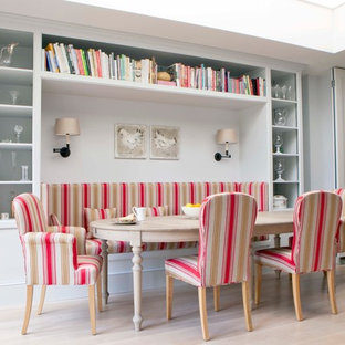 Danish light wood floor dining room photo in London
