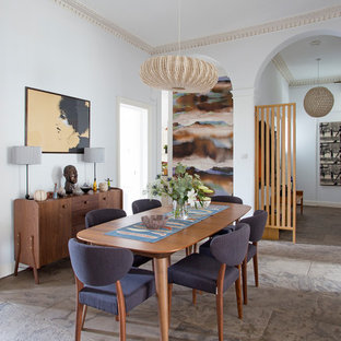 Design ideas for a contemporary dining room in Edinburgh with white walls and grey floors.