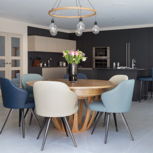 This is an example of a large contemporary kitchen/dining room in Hertfordshire with porcelain flooring, beige floors and white walls.