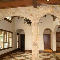 Mediterranean Dining Room by DeCavitte Properties
