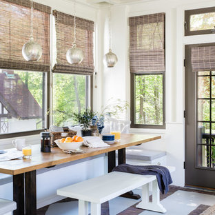 Enclosed dining room - mid-sized transitional brick floor and gray floor enclosed dining room idea in Boston with white walls