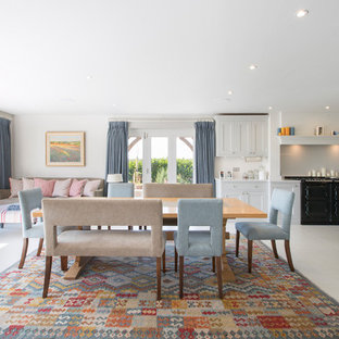 Inspiration for a rural open plan dining room in Dorset with white walls and white floors.