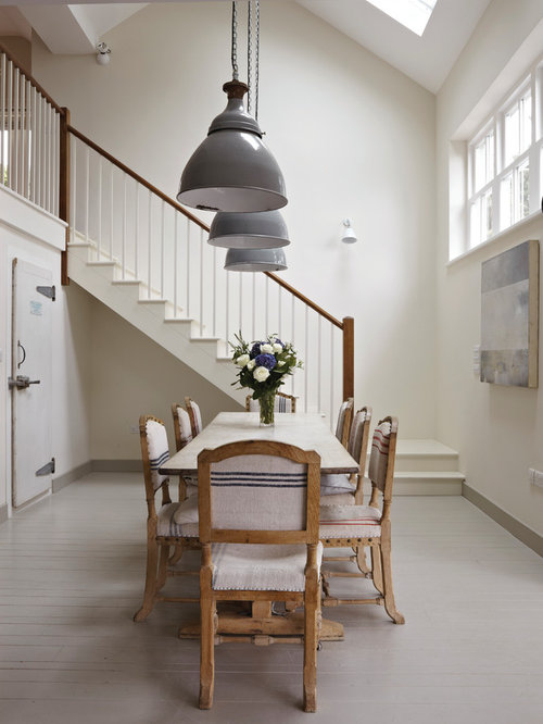 This Is An Example Of A Large Nautical Open Plan Dining Room In Dorset With White